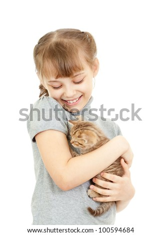 Girl hugging with British kitten isolated on white - stock photo