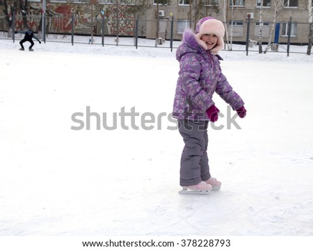 Girl ice skating in the warm clothing