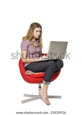 Girl in a armchair with a computer