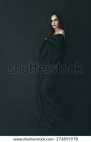 girl in a black dress in a fog - stock photo