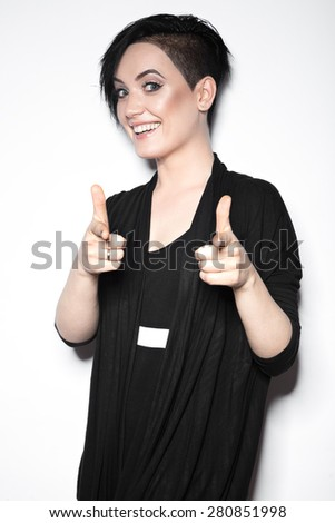 Girl in a black dress with shaved head  in art gothic style. Picture taken in the studio on a white background. - stock photo