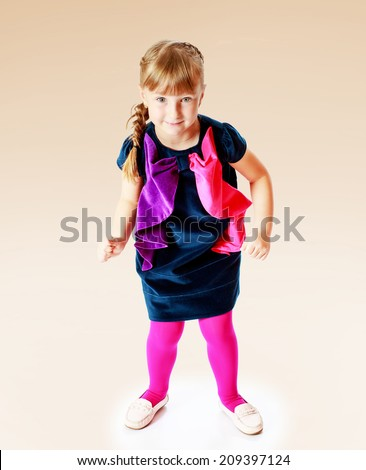 girl in a blue dress jumping.the concept of childhood and joy, teens - stock photo
