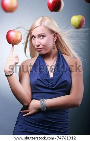girl in a blue dress with red apples - stock photo