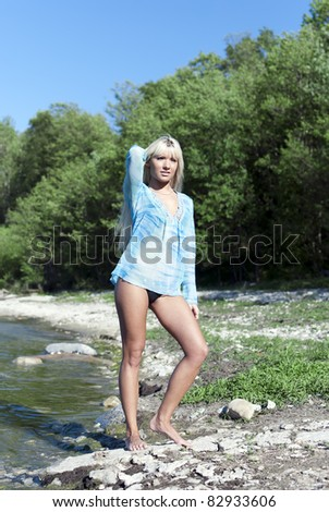 girl in a blue tunic is enjoying summer on the beach