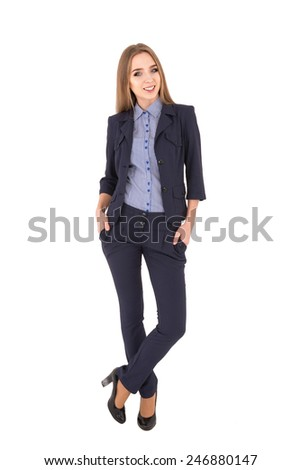 girl in a business suit on a white background. serious girl put her hands in hers pocket and looking at the camera and smiling