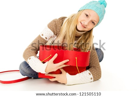 girl in a cap and scarf - stock photo