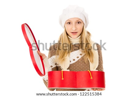Girl in a cap with a gift - stock photo