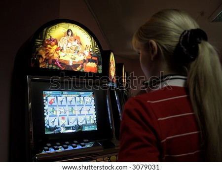 Girl in a casino, playing on a playing automat 2