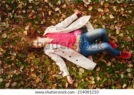 girl in a cloak lying on the ground