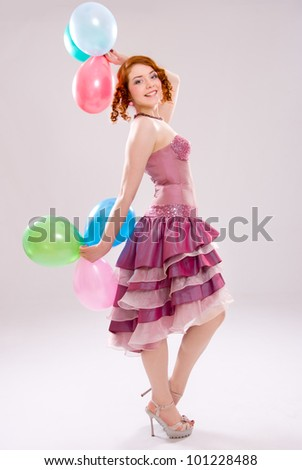 girl in a dress with balloons - stock photo