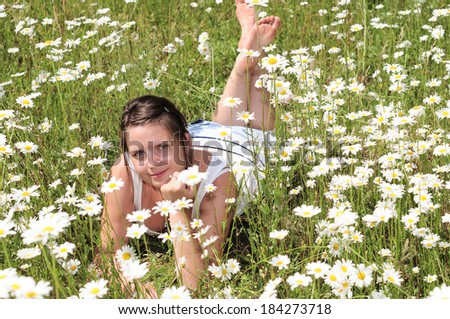 Girl in a field of meadow flowers