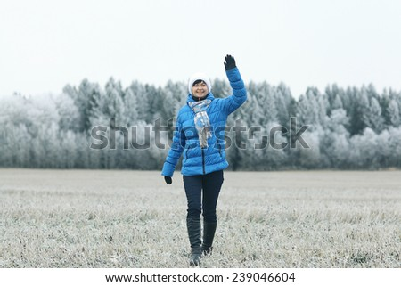 girl in a field of winter frost - stock photo