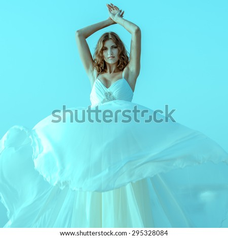 Girl in a flowing white dress - stock photo