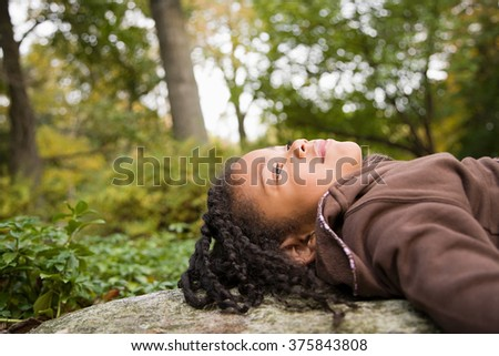 Girl in a forest - stock photo