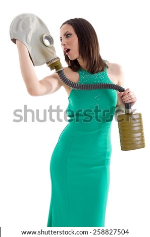 Girl in a green dress with gas mask - stock photo