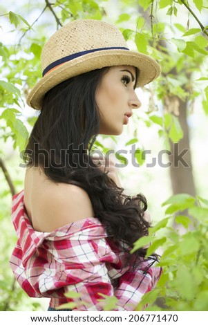 Girl in a hat and a man's shirt