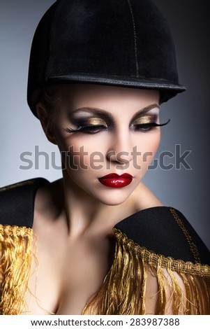 Girl in a hat and epaulets