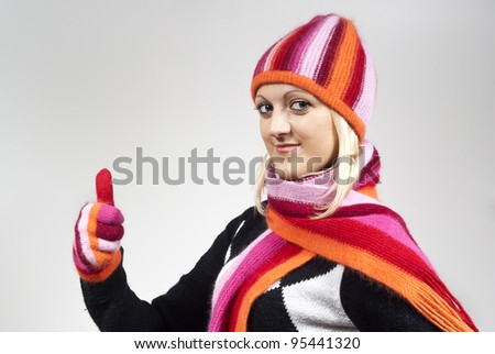 girl in a hat and gloves, shows approximately - stock photo