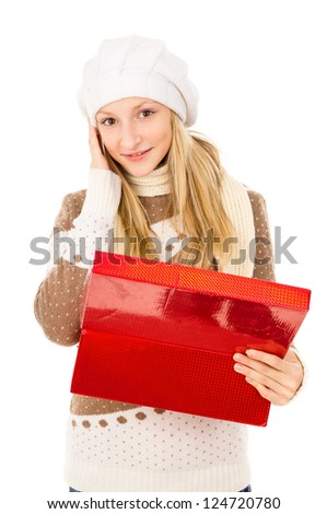 girl in a hat holding a box and surprised isolated on white background - stock photo