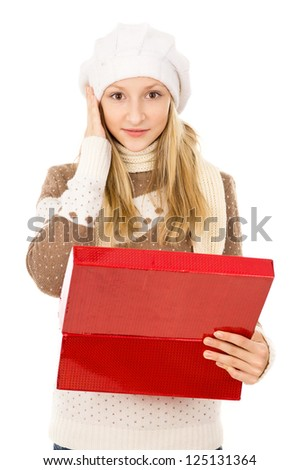 girl in a hat holding a box and wondering - stock photo