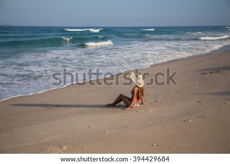 girl in a hat on the beach sea bikini