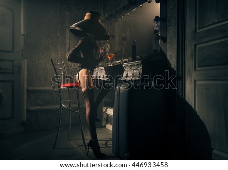 Girl in a hat sitting on a chair in the dressing room