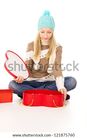girl in a hat sitting with gift boxes - stock photo