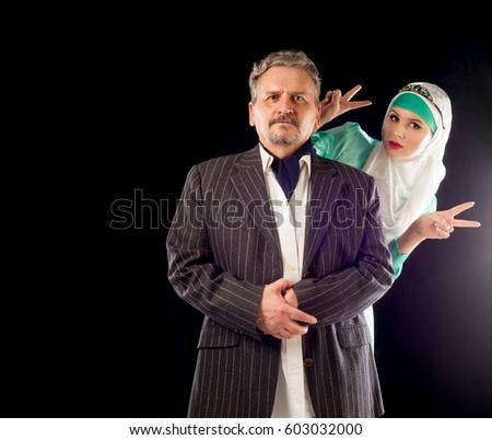 Girl in a headscarf, a man in a suit.