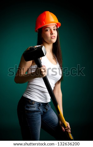 Girl in a helmet with a sledgehammer