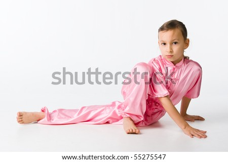 Girl in a pink kimono sitting on the floor
