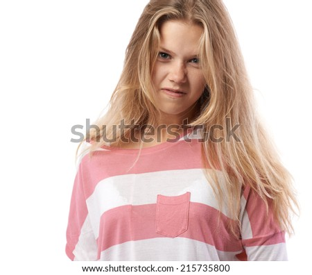 girl in a pink T-shirt very angry - stock photo