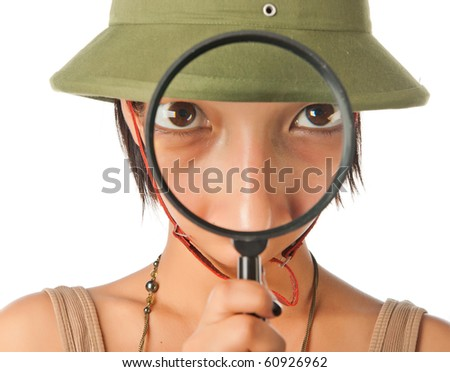Girl in a pith helmet looks throught magnifier