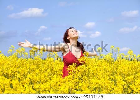 Girl in a rape field - stock photo