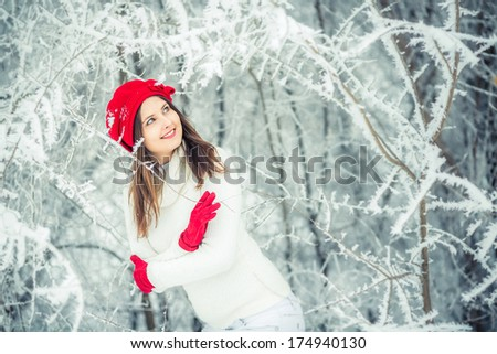 Girl in a red cap, looking wistfully into the side. - stock photo