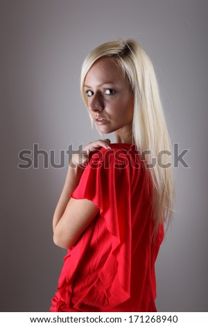 Girl in a red dress studio shot  - stock photo
