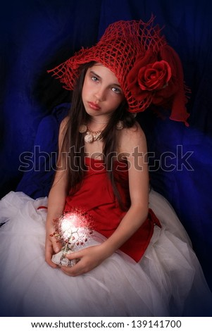 girl in a red hat with a rose on a dark background