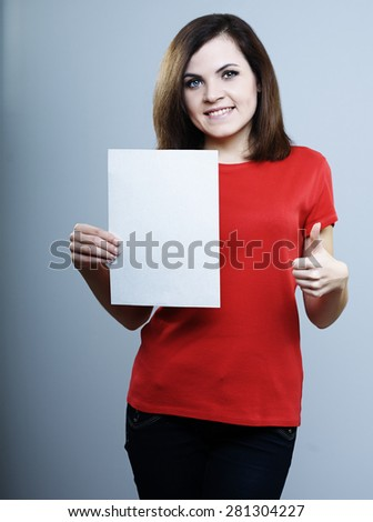 girl in a red shirt holding a poster and on the other hand shows the thumb