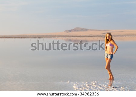 girl in a salt lake in a sunrise