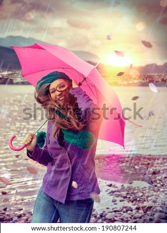 girl in a stormy day with pink umbrella - stock photo
