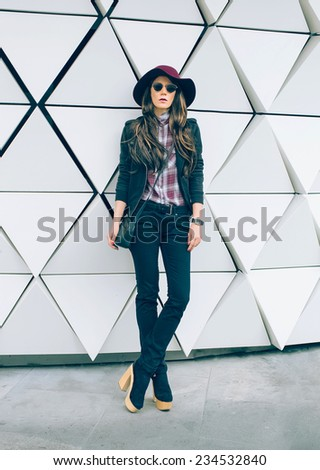 Girl in a stylish Hat on city street. Fashion style - stock photo