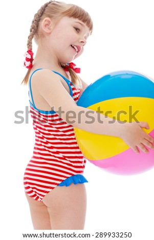 Girl in a swimsuit on the beach holding a ball - isolated on white background - stock photo