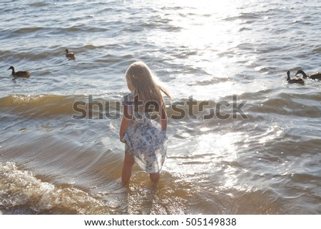 girl in a water barefoot in a summer