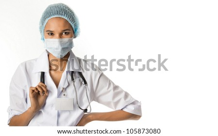 girl in a white coat in a cap and mask