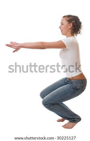 Girl in a white vest and jeans isolated on a white background