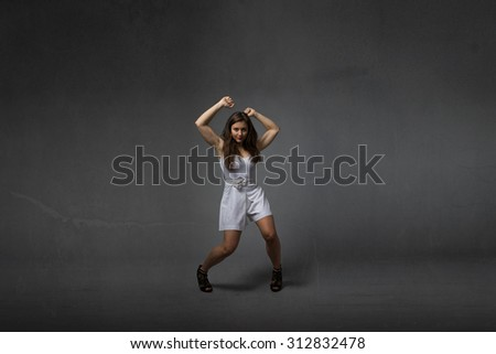 girl in a wild dancing, textured background - stock photo
