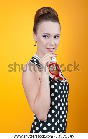 Girl in american 60s style in  polka dot dress