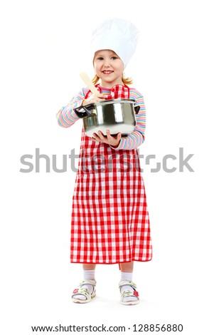 Girl in an apron and cook cap cooking delicious meal - stock photo