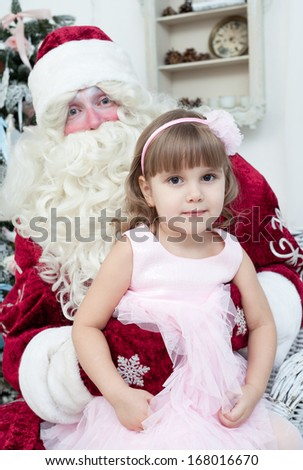 Girl in an elegant dress and Saint Nicolas