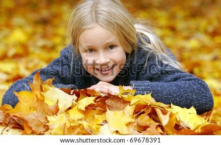 Girl in autumn park - stock photo