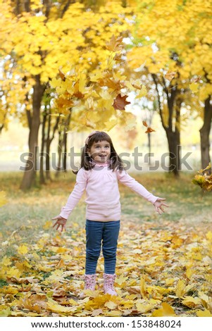 girl in autumn park. leaf fall. sunny day. - stock photo